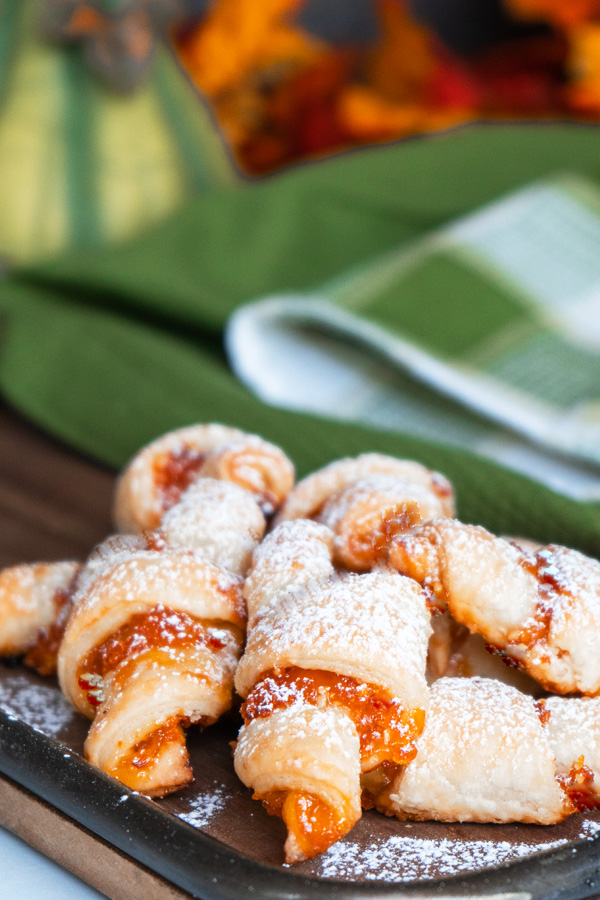 Apricot Almond Rugelach displayed on board.
