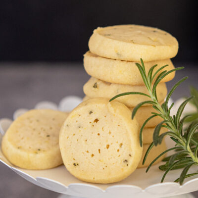 Rosemary lemon with honey cookies on white dish.