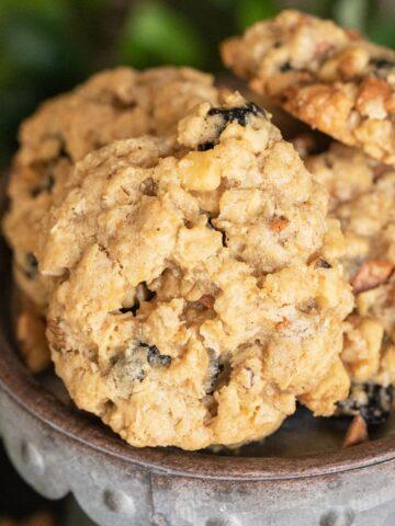 Blueberry walnut cinnamon oatmeal cookie on a metal dish.