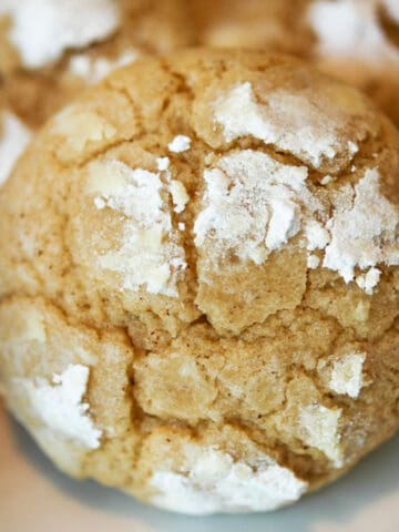 Brown butter crinkle cookie baked with powdered sugar propped up.
