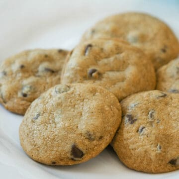 Chocolate chip cookies finished and displayed on a white plate.