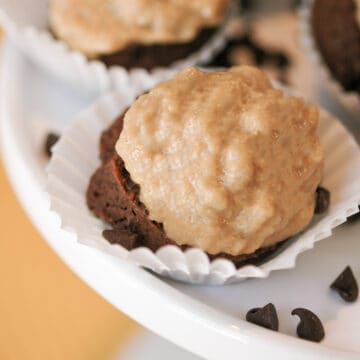 Chocolate with peanut butter cupcake cookies in a small cupcake wrapper on a white dish.