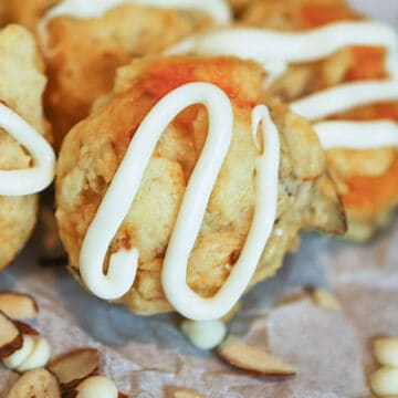 Fresh Apricot and Almond cookies with icing swirled on top.