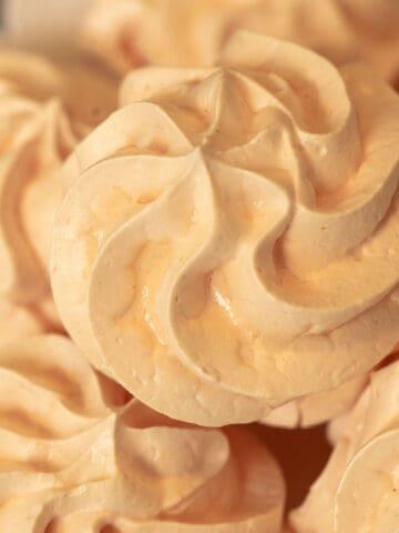 Tangerine Meringue Cookies in a swirl pattern.