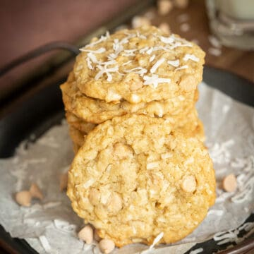 Stack of coconut with caramel sea salt on parchment paper served on old fashion dish.