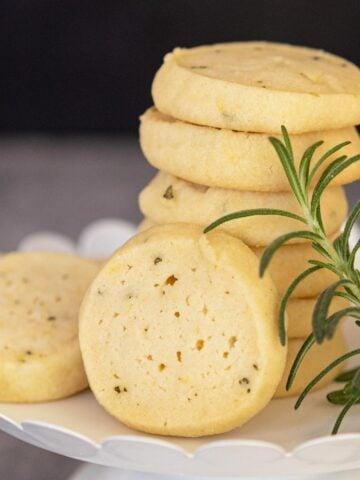 Rosemary lemon with honey cookies on white dish.