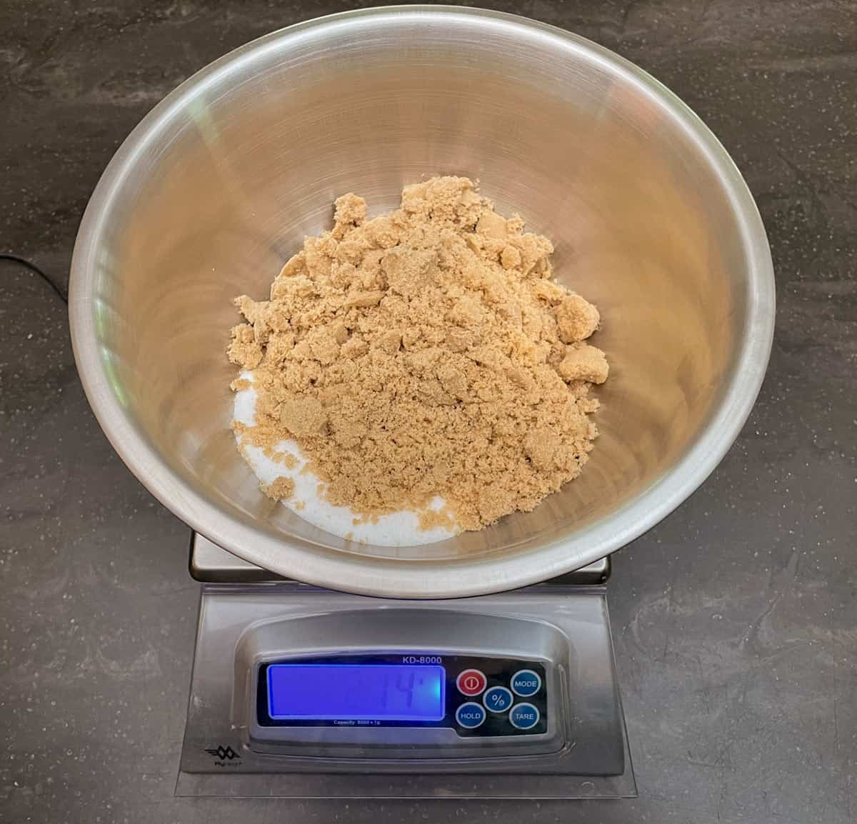 Weighing white and brown sugars on a scale.