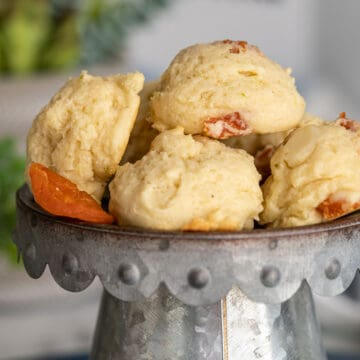 Lime with Dried Fruit and Macadamia Nut Cookies on a metal pedestal.