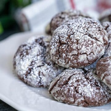 Mexican spicy chocolate crinkle cookies on a white plate ready to serve to guests.